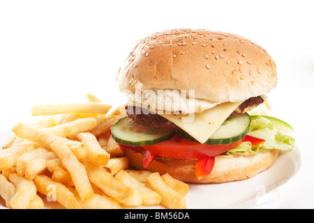 Hamburger with french fries on a dinner plate - Stock Photo