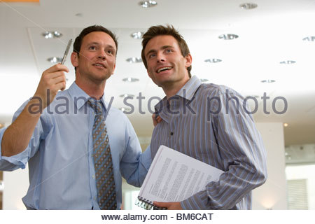 Businessmen talking together in office - Stock Photo