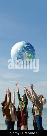 Ecology concept, group of people saving the earth together - Stock Photo