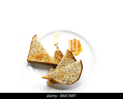 Toast and marmalade with butter - Stock Photo