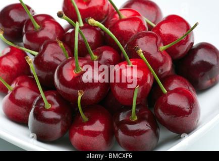 Fresh Cherries In A White Dish - Stock Photo