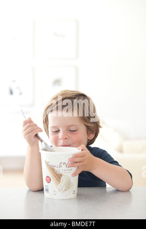 A young boy eating an ice cream cone and carrying a union flag stock photo royalty free image for Wantage swimming pool timetable