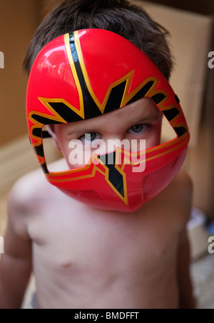 Young boy in super hero mask - Stock Photo