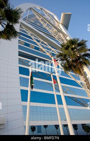 The sail shaped burj al arab hotel lit by colorful lights for Sail hotel dubai