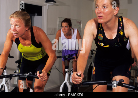 People in a spinning class at the gym. - Stock Photo