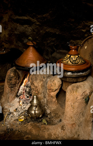 Tajine, or tagine, a type of cookware and traditional dish, that is common with Moroccan cuisine, as seen here in - Stock Photo