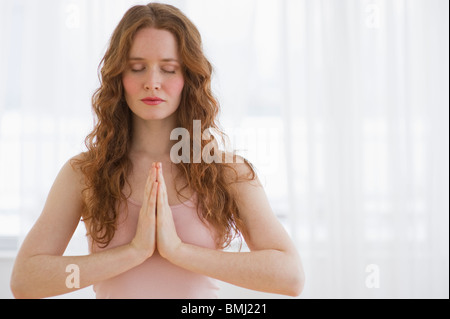 Woman meditating - Stockfoto