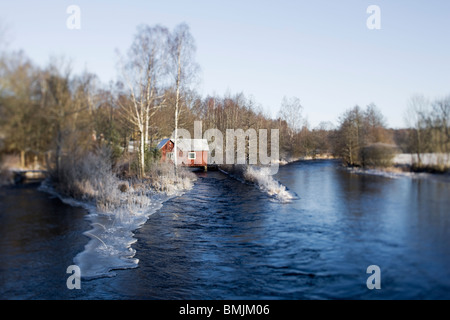 Scandinavian Peninsula, Sweden, Skane, View of house by lake - Stock Photo