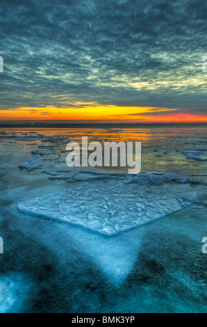 The dramatic landscape of a frozen Lake St. Clair in early morning twilight - Stock Photo