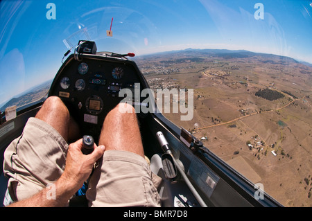 Glider pilot with hand on control stick, Boonah, Queensland, Australia - Stock Photo