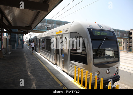Gold Line light rail transit train parked at Sierra Madre station in Pasadena, Los Angeles County. - Stock Photo
