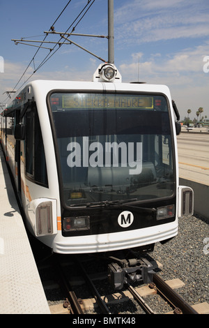Gold line light rail train parked at Sierra Madre station in Los Angeles County - Stock Photo