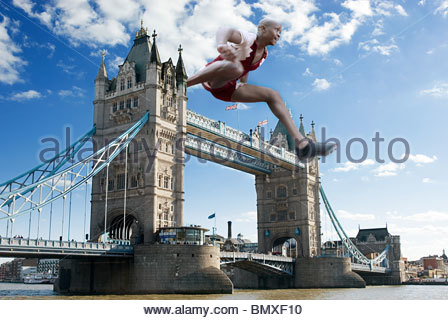 Hurdler going over tower bridge - Stock Photo