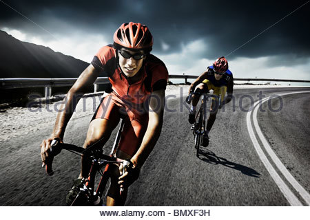 Racing cyclists on road - Stock Photo