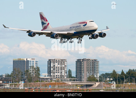 A British Airways Boeing 747-400 jet airliner on final approach for landing at Vancouver International Airport (YVR). - Stock Photo
