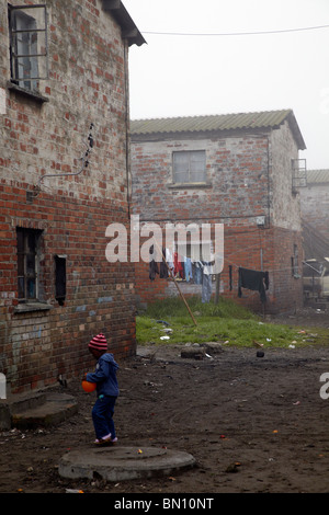 young boy playing, Langa township, Cape Town - Stock Photo