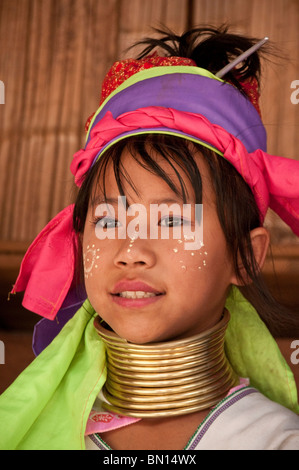 Karen hill tribe girl wearing traditional neck coil at Baan Tong Luang village of Hmong people in Chiang Mai Province - Stock Photo