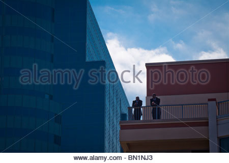 Two Men on Balcony of Hyatt Regency Jersey City New Jersey USA - Stock Photo