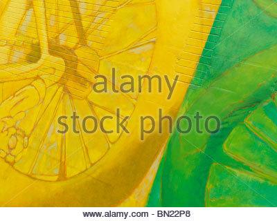 Abstract colorful yellow green mural graffiti on a brick wall - Stock Photo