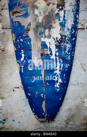 Surf board hanging in shop in Boston Bay - Stock Photo