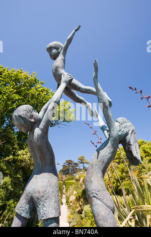 The Children of Tresco sculpture by David Wynne in the Abbey Gardens on Tresco, Isles of Scilly, UK. - Stock Photo