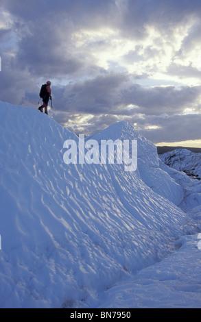 Ice Climber Walking on Ridge of Matanuska Glacier - Stock Photo