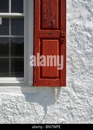 Red Shutter,  Window & White Stucco Wall, Pennsylvania USA - Stock Photo