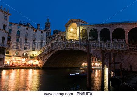 Night view of Ponte di Rialto (Rialto Bridge), Canal Grande (Grand Canal), Venice, Italy - Stock Photo