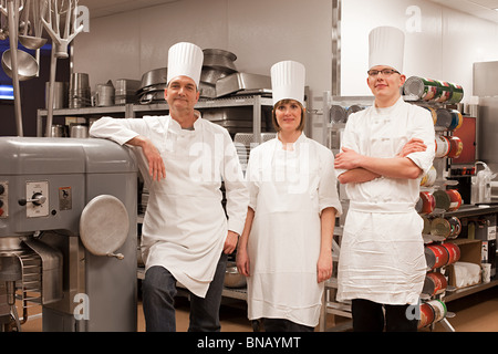 Chefs in commercial kitchen, portrait - Stock Photo