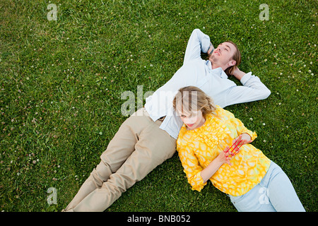 Young couple lying on grass - Stock Photo