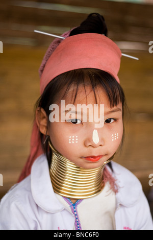 Young girl from the Padaung long neck hill tribe with traditional face markings, Tha Ton, Chiang Mai Province, Thailand - Stock Photo