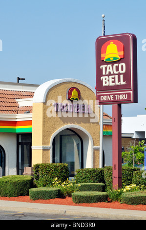 exterior of taco bell fastfood restaurant with sign logo