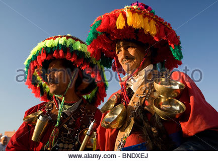 Two water sellers in a market, Djemma El Fna Square, Marrakesh, Morocco - Stock Photo