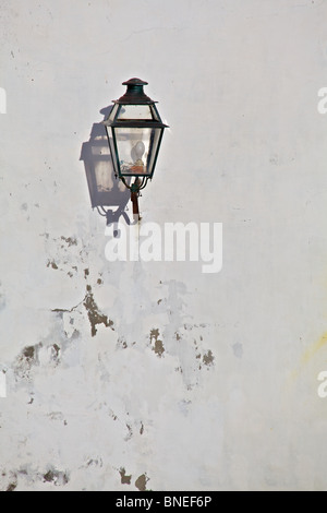 Black Metal Lantern with a Strong Shadow located in a Medieval Village in Europe - Stock Photo