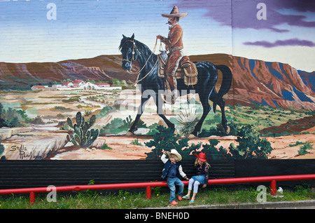 Children in front of a wall painting in the Stockyards, Fort Worth, Texas, USA - Stock Photo