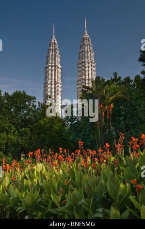 Petronas Towers in KLCC Park Kuala Lumpur Malaysia - Stock Photo