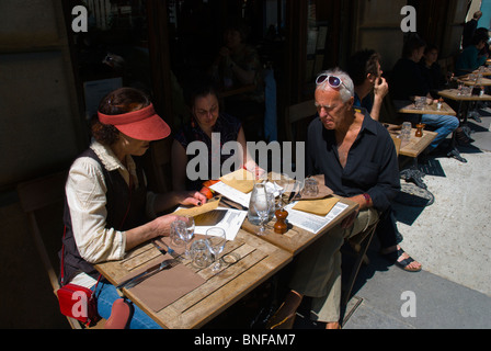 People reading menus Paris France Europe - Stock Photo