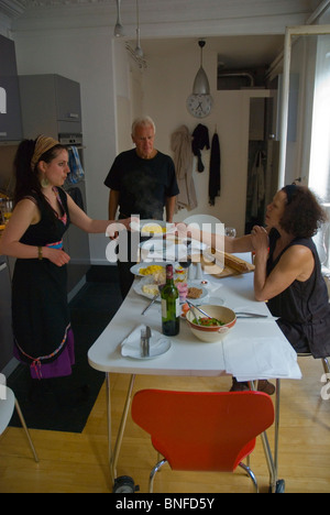 Australian having a meal in a private flat in central Paris France Europe - Stock Photo