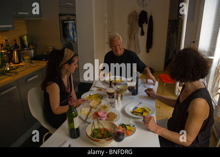 Australian family having a meal in an apartment in Le Marais district Paris France Europe - Stock Photo
