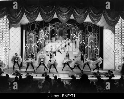Actors dancing on the stage, front view - Stock Photo