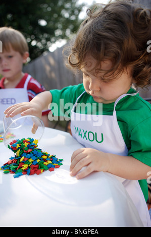 Young boy counting his candies - Stock Photo
