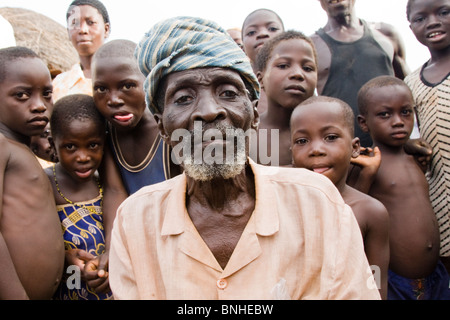 The chief of Bouchipe, a village in the Gonja Triangle, Damango district, with some of the children of the village. - Stock Photo