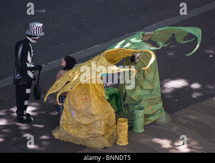 TWO FAIRIES STREET ARTISTS HUMAN STATUES IN FANCY DRESS ON LAS RAMBLAS BARCELONA SPAIN EUROPE - Stock Photo