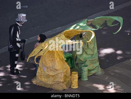 TWO FAIRIES STREET ARTISTS HUMAN STATUES IN FANCY DRESS ON LAS RAMBLAS BARCELONA SPAIN EUROPE - Stock Photo