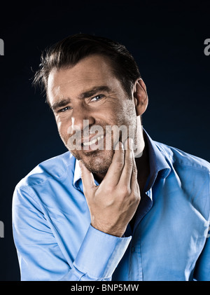 caucasian man unshaven toothache portrait isolated studio on black background - Stock Photo