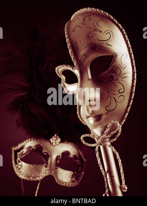 Two beautiful Venetian masks on black red background - Stock Photo