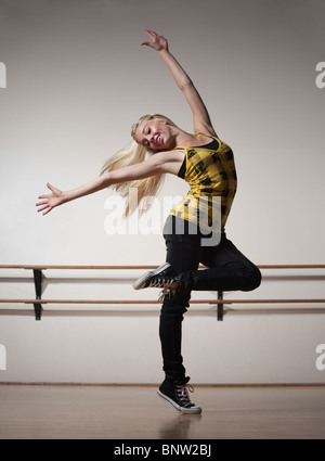 Blond woman dancing in ballet studio - Stock Photo