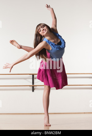 Female dancer in ballet studio - Stock Photo