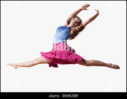 Female dancer jumping gracefully in the air - Stock Photo