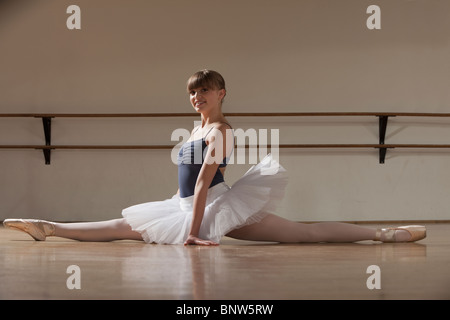 Ballet dancer doing the splits - Stock Photo
